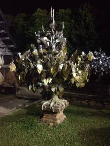 A 'tree' with golden leaves outside a Chiang Mai Temple